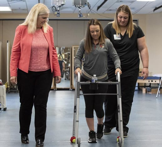 SCI Patients Walk Over Ground and on Treadmill Using Implanted Stimulator