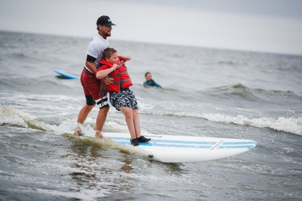 Young Patients Have a Splashing Good Time During HSS's Adaptive Surfing Trip